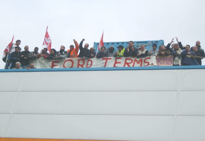 Visteon workers in a show of defiance on the roof before Unite officials got them to leave the factory at noon yesterday