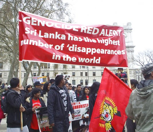 Tamils outside Parliament on Thursday condemn the Sri Lankan regime for its attacks on civilians