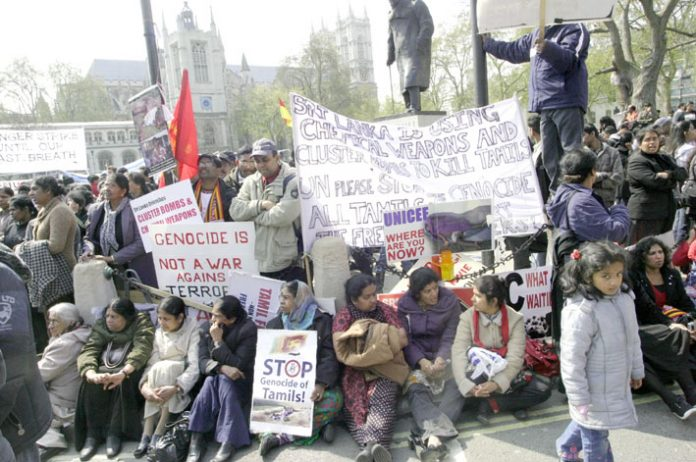 Tens of thousands joined a mass demonstration outside parliament yesterday demanding immediate action from the Brown government to stop the slaughter of Tamils by the Sri Lankan army