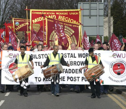 Postal workers marching in Wolverhampton against Royal Mail privatisation