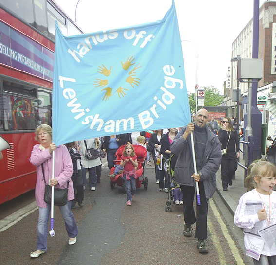'Hands off Lewisham Bridge'  banner at the front of the demonstration
