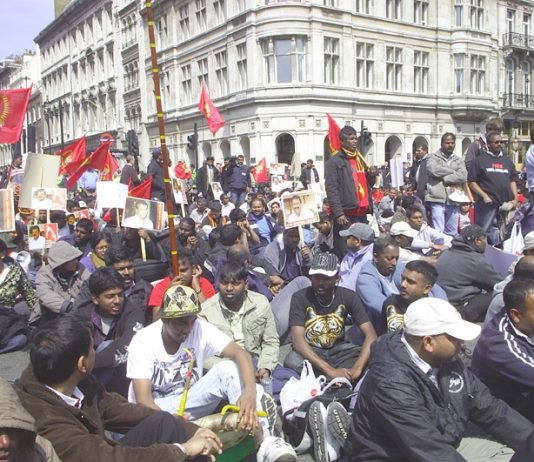 Tamils sat in the street outside Parliament to protest against the slaughter of 2000 civilians in 24 hours last week