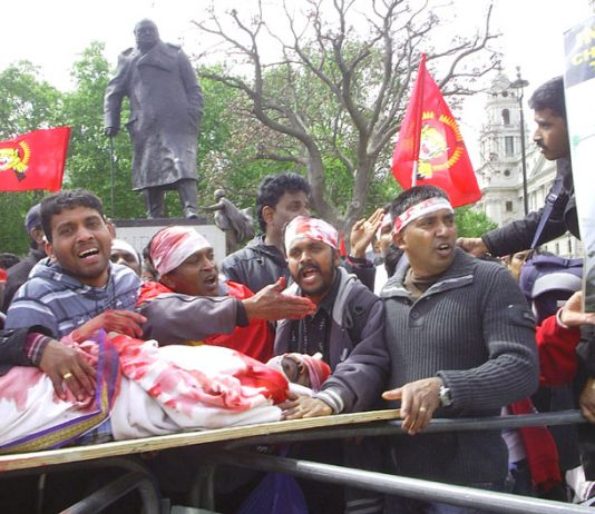 Young Tamils outside Parliament re-enacting the butchery of the Sri Lankan Army against the Tamil people