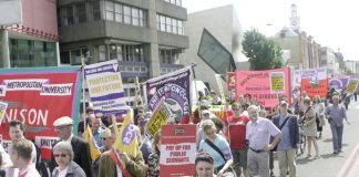 UCU, Unison and PCS members marching past London Met in Holloway Road