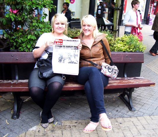 CHRISTINE O'DONNELL (holding  News Line) with a friend in Luton town centre