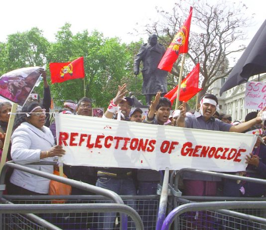 Protesters in Parliament Square against the genocidal attacks on Tamils