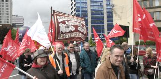 IBC banner on the Birmingham march to 'Defend Jobs' on May 16th – the Unite leaders are refusing  to take any action to defend their members jobs