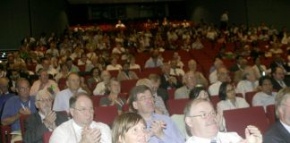 Doctors applaud one of the speakers at the BMA conference yesterday, where NHS privatisation was loudly condemned