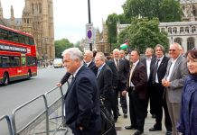 Convenors, shop stewards and Unite officials at Parliament Square awaiting the arrival of the nine-car 'drive-by' yesterday