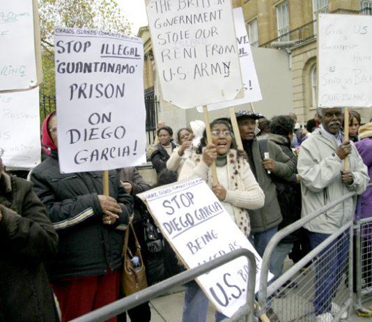 Chagos Islanders demonstrate outside Downing Street in November 2007 demanding to return to their home in Diego Garcia