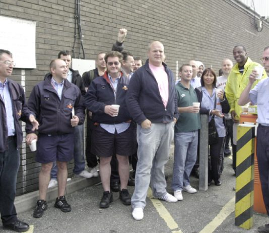 Confident pickets at Whitechapel – determined to defend the service