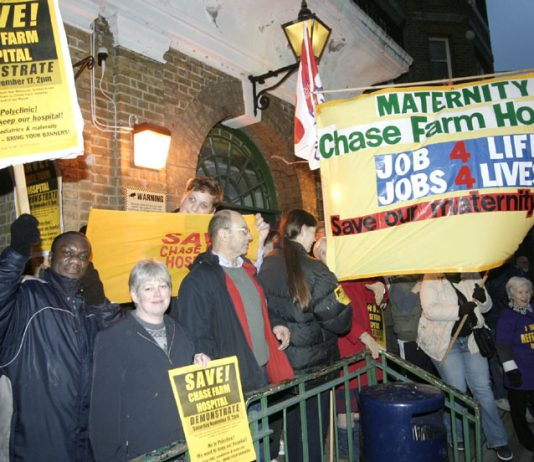 The North East London Council of Action demonstrating outside the clocktower entrance to Chase Farm Hospital. Now NHS hospitals face private takeover