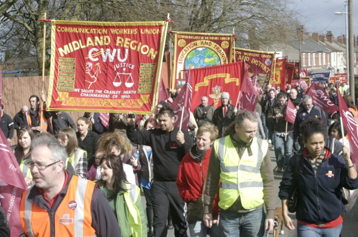 Postal workers marching in Wolverhampton against privatisation. Stoke postal workers are on strike against plans for them to travel to work in Wolverhampton – a 75 mile round trip