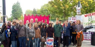 Determined striking lecturers on their picket line outside Tower Hamlets College yesterday