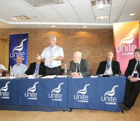Chairman DAVE OSBORNE addresses the fringe meeting with Unite joint leaders TONY WOODLEY and DEREK SIMPSON on the right of the platform