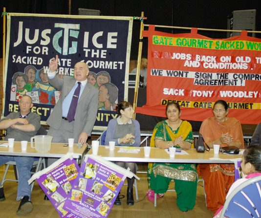STEPHEN POUND MP (centre) speaking at yesterday's fourth anniversary rally, with sacked Gate Gourmet workers also on the platform