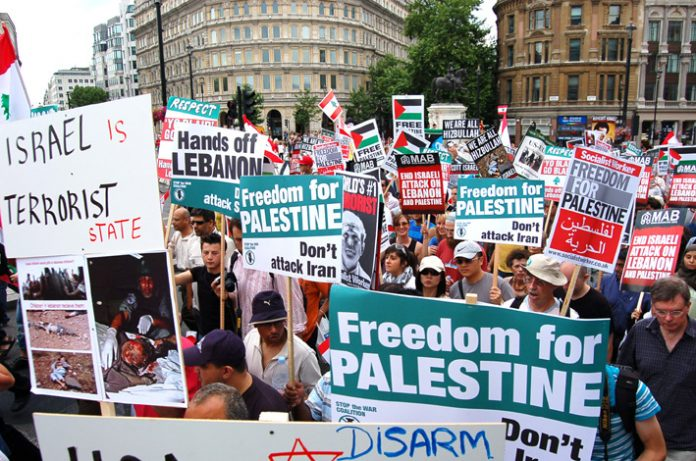 Marchers in London during the 2006 Israeli attack on the Lebanon demanding 'Free Palestine' and 'Don't attack Iran'