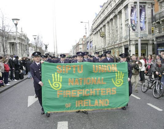 Firefighters with their banner on the 125.000-strong demonstration in Dublin on February 21st against government cuts to jobs and wages