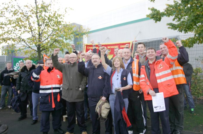 'We will win this dispute' said postal workers picketing the East London Mail Centre at Bromley-by-Bow yesterday morning