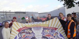 Striking CWU members in Cambridge with their banner