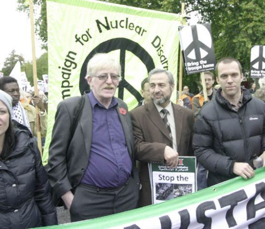Lance Corporal JOE GLENTON (far right) and his wife CLARE (left) with PETER BRIERLEY (second from left) whose son Shaun was killed in Iraq, leading off the October 24th march in London against the war on Afghanistan