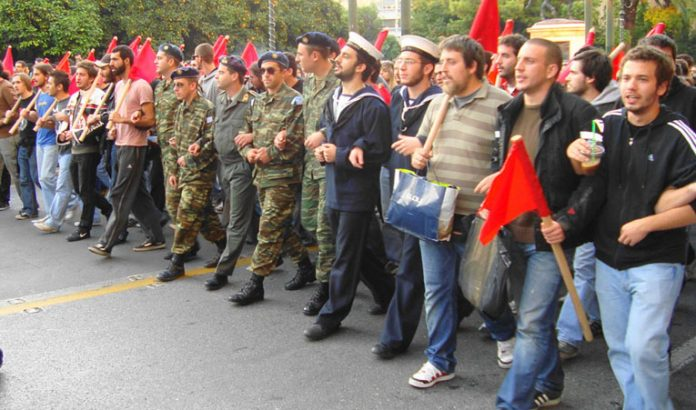 Students and conscript soldiers at the front of the demonstration