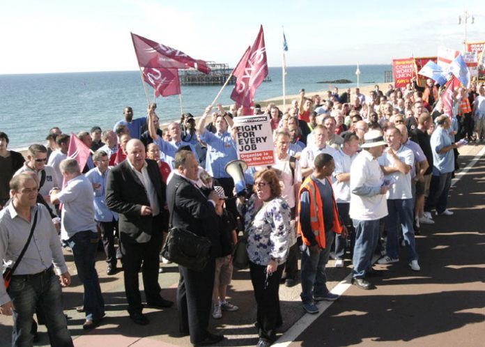 DAVE WARD and BILLY HAYES (left, in suits) with JANE LOFTUS at the postal workers' lobby of this year's Labour Party Conference in Brighton