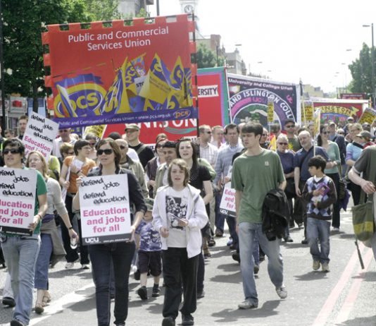 PCS banner on a march in support of London Metropolitan University workers fighting against job cuts