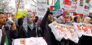 Marchers in London on January 10 last year depicting the slaughter of Palestinian children by the Israeli army last January