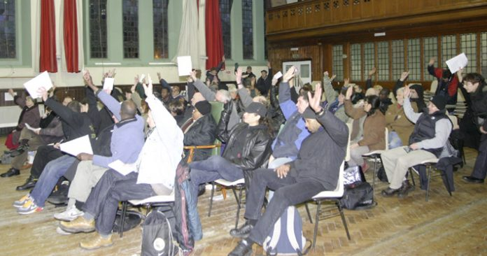 A section of the Council of Action Conference voting on the resolution
