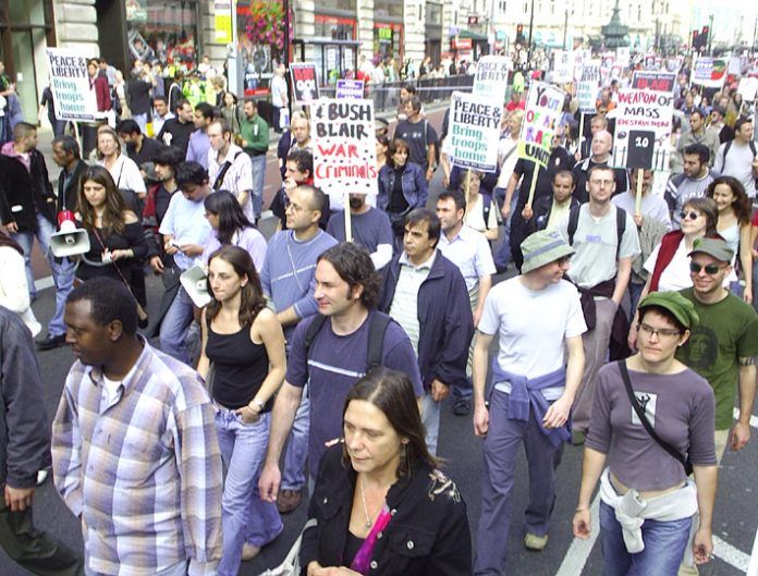 Marchers in London in September 2005 against the war on Iraq condemn Bush and Blair as war criminals