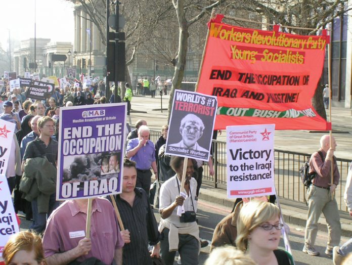 Marchers opposed to the occupation of Iraq demonstrate in March 2005