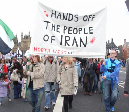Demonstrators in London defending the Iranian people against attempts by the US and UK to attack them