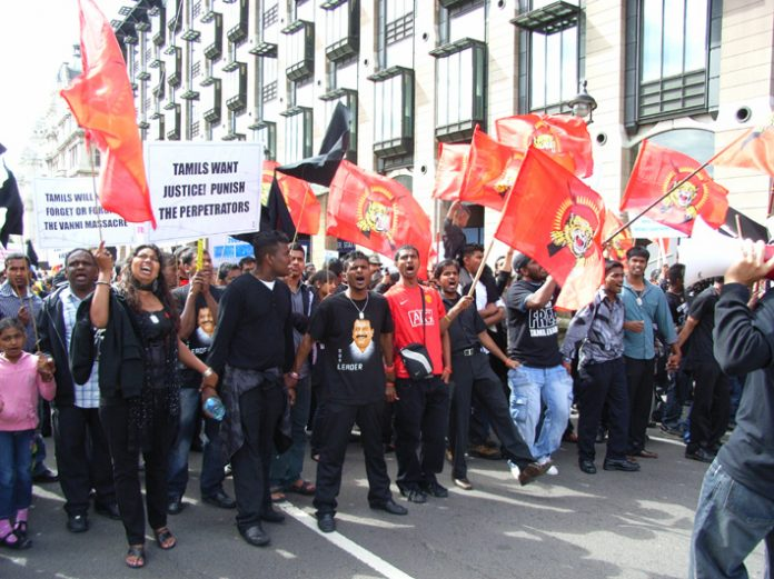 Tamils marching in London against the Sri Lankan Army atrocities in the Vanni region