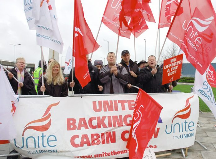 Striking BA cabin crew on the picket line at Heathrow yesterday