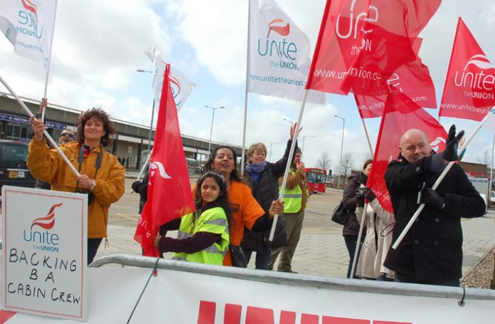 Striking BA cabin crew with  their families on the Heathrow picket line on Tuesday