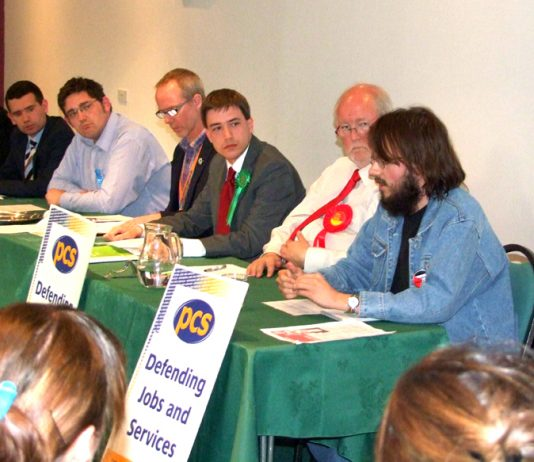 Workers Revolutionary Party Norwich Central candidate GABRIEL POLLEY speaks out to the discomfort of leading Blairite CHARLES CLARKE (second from right)