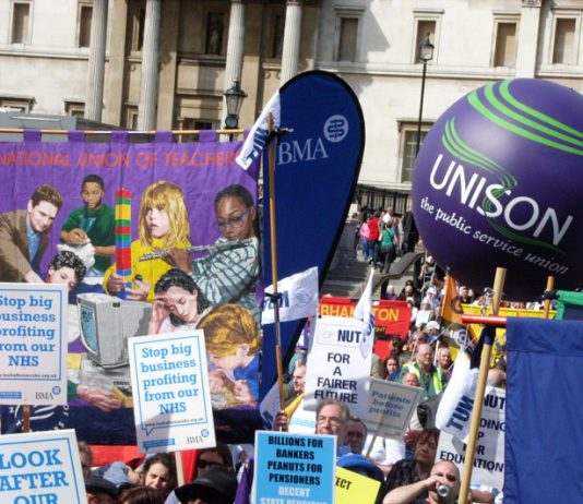 National Union of Teachers banner and Unison balloon at the Trafalgar Square rally to 'Defend the Welfare State' on April 10