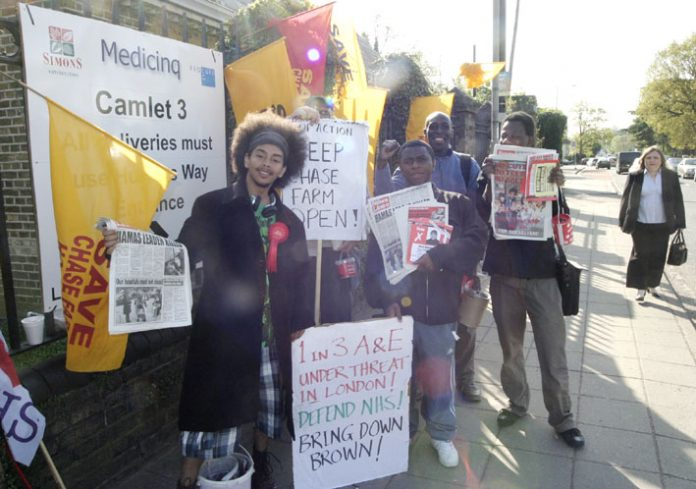 PAUL LEPPER (left) WRP canditate for Streatham joined the North East London Council of Action picket to stop the closure of Chase Farm Hospital