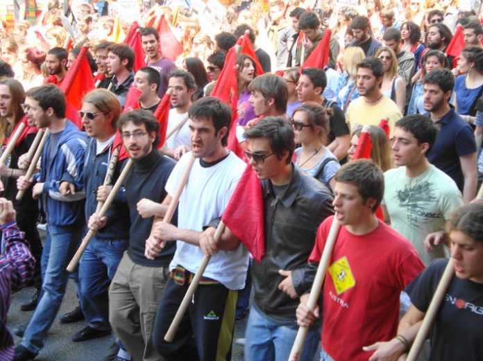 Greek youth march towards the police lines showing their determination to resist the savage cuts