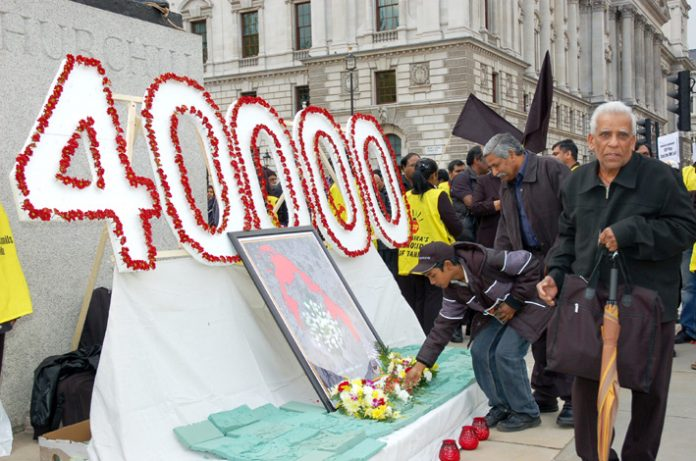 Generations of Tamils lay flowers in Parliament Square to commemorate the 40,000 civilians killed during the final stages of the Sri Lankan army war against the Tamil Tigers