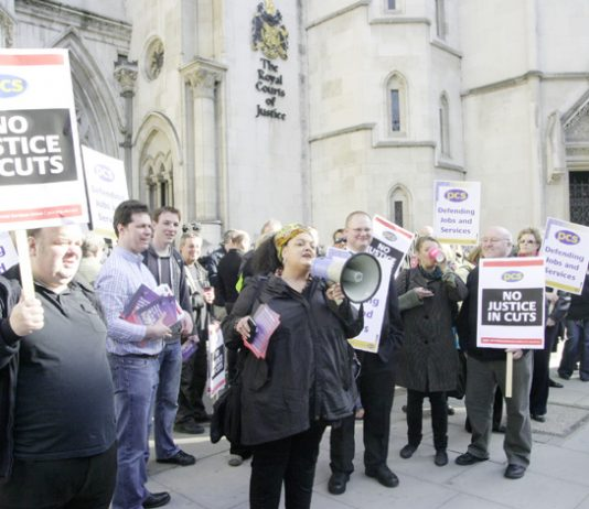 PCS members demonstrate outside the High Court during their appeal to defend their conditions