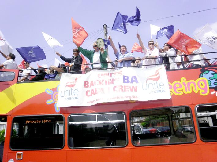 Enthusiastic striking BA cabin crew aboard their battle bus at Heathrow yesterday