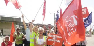 Confident striking BA cabin crew on the picket line at Heathrow yesterday
