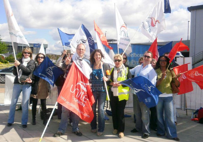 Determined BA cabin crew on the picket line at Heathrow yesterday