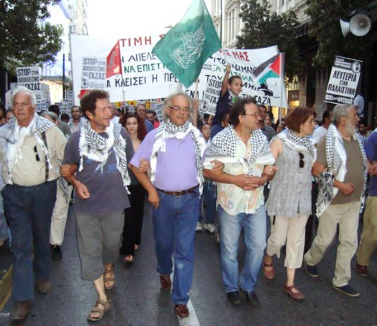 Freedom Flotilla volunteers back from a Zionist prison leading the Athens march