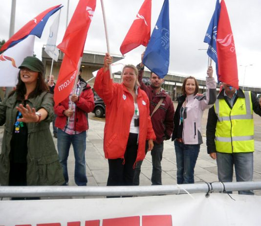 Striking BA cabin crew at Heathrow yesterday determined to win their struggle