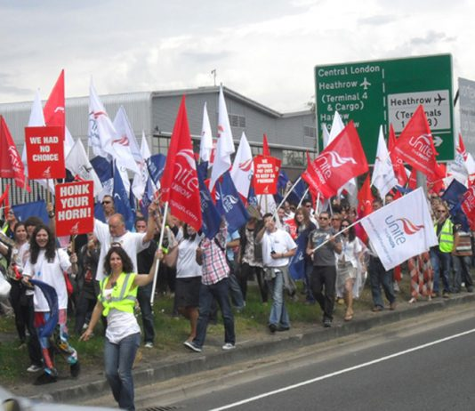 Defiant cabin crew marching around Heathrow to show that they are looking forward to the next round of the struggle with BA union-buster Walsh