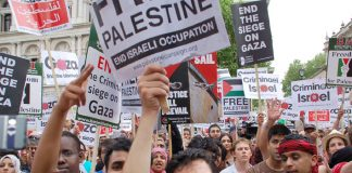 Marchers in London on June 12 condemn the Israeli attack on the siege-breaking 'Freedom Flotilla' to Gaza