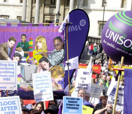 Trade unionists rally in Trafalgar Square to defend the welfare state on April 14